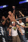 CALGARY, CANADA - JULY 21:  Renan Barao celebrates with his team after his victory over Urijah Faber after their UFC interim bantamweight championship bout at UFC 149 inside the Scotiabank Saddledome on July 21, 2012 in Calgary, Alberta, Canada.  (Photo by Nick Laham/Zuffa LLC/Zuffa LLC via Getty Images)