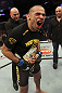 CALGARY, CANADA - JULY 21:  Renan Barao celebrates his victory over Urijah Faber as UFC President Dana White gives him the Championship belt after their UFC interim bantamweight championship bout at UFC 149 inside the Scotiabank Saddledome on July 21, 2012 in Calgary, Alberta, Canada.  (Photo by Nick Laham/Zuffa LLC/Zuffa LLC via Getty Images)