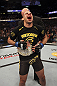 CALGARY, CANADA - JULY 21:  Renan Barao celebrates his victory over Urijah Faber during their UFC interim bantamweight championship bout at UFC 149 inside the Scotiabank Saddledome on July 21, 2012 in Calgary, Alberta, Canada.  (Photo by Nick Laham/Zuffa LLC/Zuffa LLC via Getty Images)