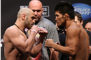 LOS ANGELES - AUGUST 03: (L-R) Opponents Manny Gamburyan and Michihiro Omigawa face off during the UFC on FOX weigh in at Staples Center on August 3, 2012 in Los Angeles, California. (Photo by Josh Hedges/Zuffa LLC/Zuffa LLC via Getty Images)