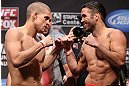 LOS ANGELES - AUGUST 03: (L-R) Joe Lauzon and Jamie Varner face off during the UFC on FOX weigh in at Staples Center on August 3, 2012 in Los Angeles, California. (Photo by Josh Hedges/Zuffa LLC/Zuffa LLC via Getty Images)