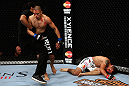 LOS ANGELES, CA - AUGUST 04:  The referee pulls John Moraga off Ulysses Gomez after Moraga knocked Gomez out in the first round during the UFC on FOX event at Staples Center on August 4, 2012 in Los Angeles, California.  (Photo by Josh Hedges/Zuffa LLC via Getty Images)