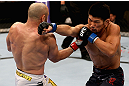 LOS ANGELES, CA - AUGUST 04:  Manny Gamburyan lands a punch on Michihiro Omigawa during their Featherweight bout at the UFC on FOX event at Staples Center on August 4, 2012 in Los Angeles, California. Gamburyan defeated Omigawa by unanimous decision.  (Photo by Josh Hedges/Zuffa LLC via Getty Images)