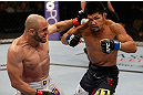 LOS ANGELES, CA - AUGUST 04:  Manny Gamburyan (L) lands a punch on Michihiro Omigawa (R) during their Featherweight bout at the UFC on FOX event at Staples Center on August 4, 2012 in Los Angeles, California. Gamburyan defeated Omigawa by unanimous decision.  (Photo by Josh Hedges/Zuffa LLC via Getty Images)