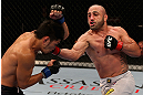 LOS ANGELES, CA - AUGUST 04:  Manny Gamburyan (R) lands a punch on Michihiro Omigawa (L) during their Featherweight bout at the UFC on FOX event at Staples Center on August 4, 2012 in Los Angeles, California. Gamburyan defeated Omigawa by unanimous decision.  (Photo by Josh Hedges/Zuffa LLC via Getty Images)