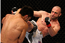 LOS ANGELES, CA - AUGUST 04:  Manny Gamburyan (R) kicks Michihiro Omigawa (L) during their Featherweight bout at the UFC on FOX event at Staples Center on August 4, 2012 in Los Angeles, California. Gamburyan defeated Omigawa by unanimous decision.  (Photo by Josh Hedges/Zuffa LLC via Getty Images)