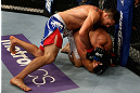 LOS ANGELES, CA - AUGUST 04:  Phil De Fries (top) takes down Oli Thompson during the UFC on FOX at Staples Center on August 4, 2012 in Los Angeles, California. De Fries defeated Thompson by way of a tap out.  (Photo by Josh Hedges/Zuffa LLC via Getty Images)