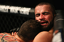 LOS ANGELES, CA - AUGUST 04:  Oli Thompson gets pinned by Phil De Fries during the UFC on FOX at Staples Center on August 4, 2012 in Los Angeles, California.  (Photo by Josh Hedges/Zuffa LLC via Getty Images)