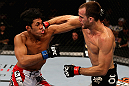 LOS ANGELES, CA - AUGUST 04:  Cole Miller (R) lands a punch on Nam Phan (L) in their featherweight bout during UFC on FOX at Staples Center on August 4, 2012 in Los Angeles, California.  Phan defeated Miller by split decision.  (Photo by Josh Hedges/Zuffa LLC via Getty Images)