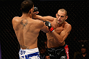 LOS ANGELES, CA - AUGUST 04:  Mike Swick (R) lands a punch on Damarques Johnson in the first round of their welterweight bout during UFC on FOX at Staples Center on August 4, 2012 in Los Angeles, California.  (Photo by Josh Hedges/Zuffa LLC via Getty Images)