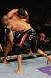 LOS ANGELES, CA - AUGUST 04:  Mike Swick pins Damarques Johnson against the cage during the UFC on FOX at Staples Center on August 4, 2012 in Los Angeles, California.  (Photo by Josh Hedges/Zuffa LLC via Getty Images)