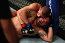 LOS ANGELES, CA - AUGUST 04:  Joe Lauzon (top) takes down Jamie Varner in their lightweight bout during the UFC on FOX at Staples Center on August 4, 2012 in Los Angeles, California. Lauzon won by way of submission by triangle choke.  (Photo by Josh Hedges/Zuffa LLC via Getty Images)