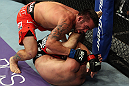 LOS ANGELES, CA - AUGUST 04:  Jamie Varner takes down Joe Lauzon in their lightweight bout during the UFC on FOX at Staples Center on August 4, 2012 in Los Angeles, California. Lauzon won by way of submission by triangle choke.  (Photo by Josh Hedges/Zuffa LLC via Getty Images)