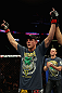 LOS ANGELES, CA - AUGUST 04:  Joe Lauzon celebrates after defeating Jamie Varner in their lightweight bout during the UFC on FOX at Staples Center on August 4, 2012 in Los Angeles, California. Lauzon won by way of submission by triangle choke. (Photo by Josh Hedges/Zuffa LLC via Getty Images)