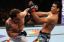 LOS ANGELES, CA - AUGUST 04:  Ryan Bader exchanges strikes with Lyoto Machida in their light heavyweight bout during the UFC on FOX at Staples Center on August 4, 2012 in Los Angeles, California. Machida won the bout by way of knock out in the second round.  (Photo by Josh Hedges/Zuffa LLC/Zuffa LLC via Getty Images)