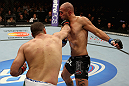 LOS ANGELES, CA - AUGUST 04:  Shogun Rua (L) lands a punch to the throat of Brandon Vera (R) in their light heavyweight bout during the UFC on FOX at Staples Center on August 4, 2012 in Los Angeles, California. Rua defeated Vera by way of TKO in the fourth round.  (Photo by Josh Hedges/Zuffa LLC/Zuffa LLC via Getty Images)