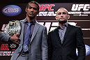 DENVER, CO - AUGUST 09:  (L-R) Opponents Benson Henderson and Frankie Edgar pose for photos during the UFC 150 press conference at the Fillmore Auditorium on August 9, 2012 in Denver, Colorado. (Photo by Josh Hedges/Zuffa LLC/Zuffa LLC via Getty Images)