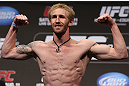 DENVER, CO - AUGUST 10:  Tom Hayden makes weight during the UFC 150 weigh in at Pepsi Center on August 10, 2012 in Denver, Colorado. (Photo by Josh Hedges/Zuffa LLC/Zuffa LLC via Getty Images)
