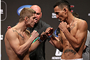 DENVER, CO - AUGUST 10:  (L-R) Opponents Justin Lawrence and Max Holloway face off during the UFC 150 weigh in at Pepsi Center on August 10, 2012 in Denver, Colorado. (Photo by Josh Hedges/Zuffa LLC/Zuffa LLC via Getty Images)