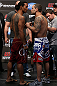 DENVER, CO - AUGUST 10:  (L-R) Opponents Benson Henderson and Frankie Edgar face off during the UFC 150 weigh in at Pepsi Center on August 10, 2012 in Denver, Colorado. (Photo by Josh Hedges/Zuffa LLC/Zuffa LLC via Getty Images)