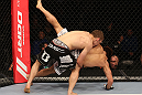DENVER, CO - AUGUST 11:  (L-R) Nik Lentz takes down Eiji Mitsuoka during their featherweight bout at UFC 150 inside Pepsi Center on August 11, 2012 in Denver, Colorado. (Photo by Nick Laham/Zuffa LLC/Zuffa LLC via Getty Images)