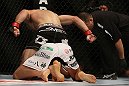 DENVER, CO - AUGUST 11:  Nik Lentz (black shorts) punches down at Eiji Mitsuoka during their featherweight bout at UFC 150 inside Pepsi Center on August 11, 2012 in Denver, Colorado. (Photo by Josh Hedges/Zuffa LLC/Zuffa LLC via Getty Images)