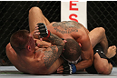 DENVER, CO - AUGUST 11:  (L-R) Dustin Pague delivers an elbow strike against Chico Camus on the ground during their bantamweight bout at UFC 150 inside Pepsi Center on August 11, 2012 in Denver, Colorado. (Photo by Josh Hedges/Zuffa LLC/Zuffa LLC via Getty Images)