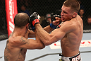 DENVER, CO - AUGUST 11:  (R-L) Dustin Pague punches Chico Camus during their bantamweight bout at UFC 150 inside Pepsi Center on August 11, 2012 in Denver, Colorado. (Photo by Nick Laham/Zuffa LLC/Zuffa LLC via Getty Images)