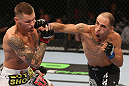 DENVER, CO - AUGUST 11:  (R-L) Chico Camus punches Dustin Pague during their bantamweight bout at UFC 150 inside Pepsi Center on August 11, 2012 in Denver, Colorado. (Photo by Nick Laham/Zuffa LLC/Zuffa LLC via Getty Images)