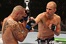 DENVER, CO - AUGUST 11:  (R-L) Jared Hamman punches Michael Kuiper during their middleweight bout at UFC 150 inside Pepsi Center on August 11, 2012 in Denver, Colorado. (Photo by Nick Laham/Zuffa LLC/Zuffa LLC via Getty Images)