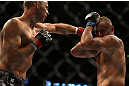 DENVER, CO - AUGUST 11:  (L-R) Jared Hamman punches Michael Kuiper during their middleweight bout at UFC 150 inside Pepsi Center on August 11, 2012 in Denver, Colorado. (Photo by Josh Hedges/Zuffa LLC/Zuffa LLC via Getty Images)