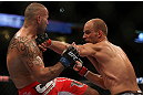 DENVER, CO - AUGUST 11:  (R-L) Jared Hamman punches Michael Kuiper during their middleweight bout at UFC 150 inside Pepsi Center on August 11, 2012 in Denver, Colorado. (Photo by Josh Hedges/Zuffa LLC/Zuffa LLC via Getty Images)