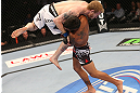 DENVER, CO - AUGUST 11:  (R-L) Dennis Bermudez takes down Tommy Hayden during their featherweight bout at UFC 150 inside Pepsi Center on August 11, 2012 in Denver, Colorado. (Photo by Nick Laham/Zuffa LLC/Zuffa LLC via Getty Images)