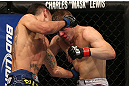 DENVER, CO - AUGUST 11:  (L-R) Max Holloway punches Justin Lawrence during their featherweight bout at UFC 150 inside Pepsi Center on August 11, 2012 in Denver, Colorado. (Photo by Josh Hedges/Zuffa LLC/Zuffa LLC via Getty Images)