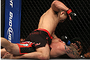 DENVER, CO - AUGUST 11:  Yushin Okami (top) punches down at Buddy Roberts during their middleweight bout at UFC 150 inside Pepsi Center on August 11, 2012 in Denver, Colorado. (Photo by Josh Hedges/Zuffa LLC/Zuffa LLC via Getty Images)