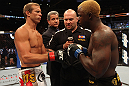 "DENVER, CO - AUGUST 11:  (L-R) Donald ""Cowboy"" Cerrone and Melvin Guillard receive final instructions from the referee before their lightweight bout at UFC 150 inside Pepsi Center on August 11, 2012 in Denver, Colorado. (Photo by Nick Laham/Zuffa LLC/Zuffa LLC via Getty Images)"
