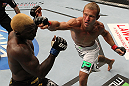 "DENVER, CO - AUGUST 11:  (R-L) Donald ""Cowboy"" Cerrone knocks out Melvin Guillard with a punch during their lightweight bout at UFC 150 inside Pepsi Center on August 11, 2012 in Denver, Colorado. (Photo by Josh Hedges/Zuffa LLC/Zuffa LLC via Getty Images)"