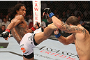DENVER, CO - AUGUST 11:  (L-R) Benson Henderson kicks Frankie Edgar during their lightweight championship bout at UFC 150 inside Pepsi Center on August 11, 2012 in Denver, Colorado. (Photo by Nick Laham/Zuffa LLC/Zuffa LLC via Getty Images)