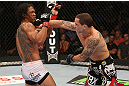 DENVER, CO - AUGUST 11:  (R-L) Frankie Edgar punches Benson Henderson during their lightweight championship bout at UFC 150 inside Pepsi Center on August 11, 2012 in Denver, Colorado. (Photo by Nick Laham/Zuffa LLC/Zuffa LLC via Getty Images)