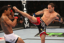 DENVER, CO - AUGUST 11:  (R-L) Frankie Edgar kicks Benson Henderson during their lightweight championship bout at UFC 150 inside Pepsi Center on August 11, 2012 in Denver, Colorado. (Photo by Nick Laham/Zuffa LLC/Zuffa LLC via Getty Images)