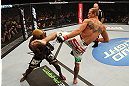 "DENVER, CO - AUGUST 11:  (R-L) Donald ""Cowboy"" Cerrone kicks Melvin Guillard during their lightweight bout at UFC 150 inside Pepsi Center on August 11, 2012 in Denver, Colorado. (Photo by Nick Laham/Zuffa LLC/Zuffa LLC via Getty Images)"