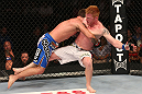 DENVER, CO - AUGUST 11:  (L-R) Jake Shields takes down Ed Herman during their middleweight bout at UFC 150 inside Pepsi Center on August 11, 2012 in Denver, Colorado. (Photo by Nick Laham/Zuffa LLC/Zuffa LLC via Getty Images)