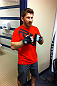 DENVER, CO - AUGUST 11:  UFC fighter Mike Brown tries on gloves while his teammate Ken Stone gets wrapped at UFC 150 inside Pepsi Center on August 11, 2012 in Denver, Colorado. (Zuffa LLC)