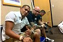 "DENVER, CO - AUGUST 11:  UFC fighter Anthony ""Showtime"" Pettis in the locker room with teammate Chico Camus while attending UFC 150 inside Pepsi Center on August 11, 2012 in Denver, Colorado. (Zuffa LLC)"