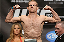 TORONTO, CANADA - SEPTEMBER 21: Evan Dunham weighs in during the UFC 152 weigh in at Mattamy Athletic Centre at the Gardens on September 21, 2012 in Toronto, Ontario, Canada. (Photo by Josh Hedges/Zuffa LLC/Zuffa LLC via Getty Images)
