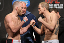 TORONTO, CANADA - SEPTEMBER 21: (L-R) Opponents T.J. Grant and Evan Dunham face off during the UFC 152 weigh in at Mattamy Athletic Centre at the Gardens on September 21, 2012 in Toronto, Ontario, Canada. (Photo by Josh Hedges/Zuffa LLC/Zuffa LLC via Getty Images)
