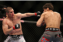 TORONTO, CANADA - SEPTEMBER 22: (L-R) Seth Baczynski punches Simeon Thoresen during their welterweight bout at UFC 152 inside Air Canada Centre on September 22, 2012 in Toronto, Ontario, Canada. (Photo by Josh Hedges/Zuffa LLC/Zuffa LLC via Getty Images)