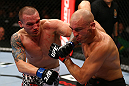 TORONTO, CANADA - SEPTEMBER 22: (L-R) Lance Benoist punches Sean Pierson during their welterweight bout at UFC 152 inside Air Canada Centre on September 22, 2012 in Toronto, Ontario, Canada. (Photo by Al Bello/Zuffa LLC/Zuffa LLC via Getty Images)