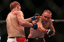 TORONTO, CANADA - SEPTEMBER 22: (R-L) T.J. Grant punches Evan Dunham during their lightweight bout at UFC 152 inside Air Canada Centre on September 22, 2012 in Toronto, Ontario, Canada. (Photo by Josh Hedges/Zuffa LLC/Zuffa LLC via Getty Images)