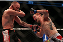 TORONTO, CANADA - SEPTEMBER 22: (R-L) Evan Dunham punches T.J. Grant during their lightweight bout at UFC 152 inside Air Canada Centre on September 22, 2012 in Toronto, Ontario, Canada. (Photo by Josh Hedges/Zuffa LLC/Zuffa LLC via Getty Images)